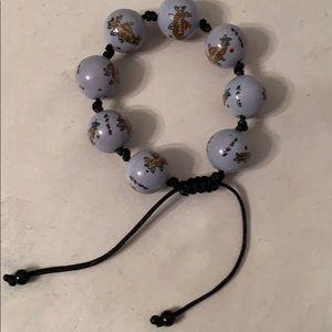 Lilac colored adjustable 8 bead bracelet